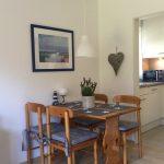 Essbereich und Blick in die Küche Ferienhaus Roese